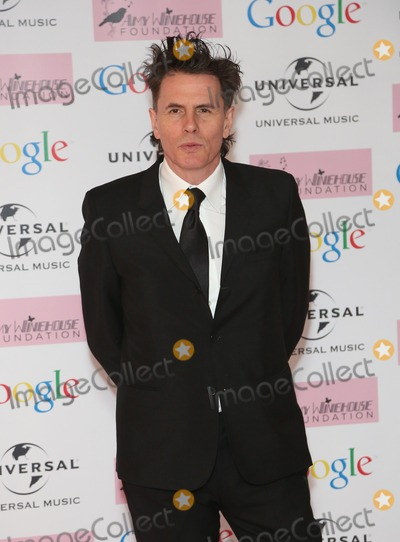 Amy Winehouse Photo - John Taylor arriving for the Amy Winehouse Foundation Dinner London 20112013 Picture by Henry Harris  Featureflash
