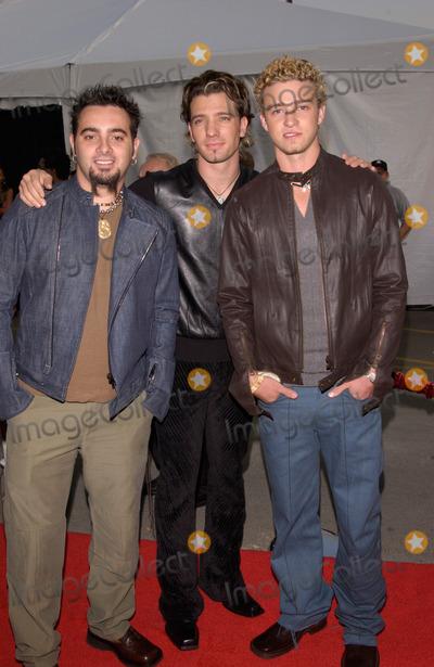 JC Chasez Photo - NSYNC stars JUSTIN TIMBERLAKE JC CHASEZ  CHRIS KIRKPATRICK at the American Music Awards in Los Angeles09JAN2002   Paul SmithFeatureflash