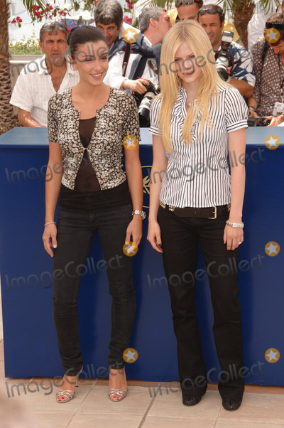 Jenifer Bartoli Photo - Singers AVRIL LAVIGNE (right)  JENIFER BARTOLI at photocall for Over the Hedge at the 59th Annual International Film Festival de CannesMay 17 2006  Cannes France 2006 Paul Smith  Featureflash