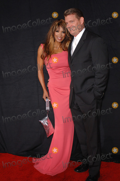 Traci Bingham Photo - Actress TRACI BINGHAM  fianc JOHN EDWARD YARBROUGH at the premiere for season three of the TV series NipTuck at the El Capitan Theatre HollywoodSeptember 10 2005  Los Angeles CA 2005 Paul Smith  Featureflash
