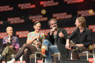 Austin Amelio Photo - MANNHEIM GERMANY - MARCH 17 (L to R) Presenter  Actors Pollyanna McIntosh Steven Ogg Austin Amelio (The Walking Dead) panel at Walker Stalker Germany convention (Photo by Markus Wissmann)