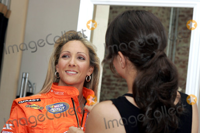 NASCAR DRIVERS Photo - Female Nascar driver Kim Crosby during a photo shoot with her new sponsor Vassarette Lingeries new driving suit gets some help from a stylist August 23 2005 in New York City