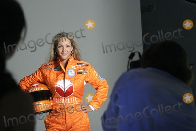 NASCAR DRIVERS Photo - Female Nascar driver Kim Crosby during a photo shoot with her new sponsor Vassarette Lingeries new driving suit August 23 2005 in New York City