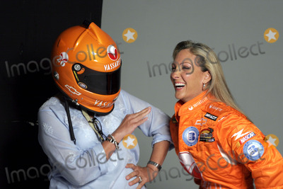 NASCAR DRIVERS Photo - Female Nascar driver Kim Crosby (R) and photographer Marili Forestieri during a photo shoot in Chelsea Kim Crosby is wearing her new sponsor Vassarette Lingeries new driving suit while Ms Forestieri dons the new helmet August 23 2005 in New York City August 23 2005  Fernando Leon  Retna Ltd