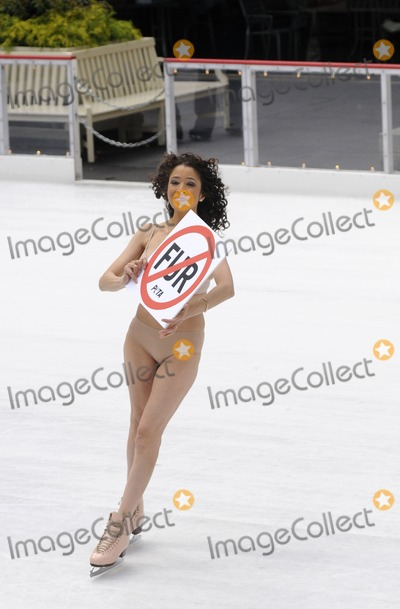 Tai Babilonia Photo - Olympic skater Tai Babilonia skates nude for PETA at Rockefeller Center in New York City on November 24 2009