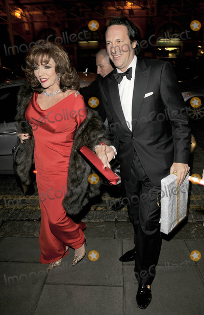 Christopher Biggins Photo - London UK Joan Collins and Percy Gibson at the Christopher Biggins 60th Birthday party held at the Landmark Hotel in London 15th December 2008Ref LMK315-Can NguyenLandmark Media