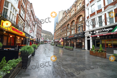 Leicester Square Photo - London UK Leicester Square Large empty spaces where tourists usually gather and deserted streets around landmarks due to the threat of a further spread of coronavirus -COVID-19   London 19th March 2020Ref LMK73-J6378-200320Keith MayhewLandmark MediaWWWLMKMEDIACOM