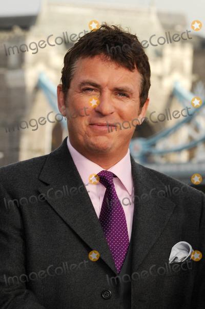 George Cole Photo - London UK Shane Richie poses to launch Fives remake of the popular 80s sitcom starring Dennis Waterman and George Cole at Tower Bridge13 JanuaryAli KadinskyLandmark Media