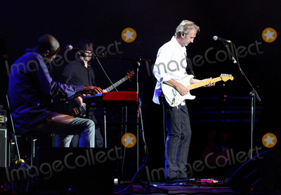Mike Rutherford Photo - St Albans UK Mike and the Mechanics - formed by Genesis guitarist Mike Rutherford and also featuring lead singer Tim Howar and on keyboards and lead vocals Andrew Roachford play live at the Alban Arena St Albans Hertfordshire on March 9th 2014Ref LMK73-44847-100314Keith MayhewLandmark Media WWWLMKMEDIACOM