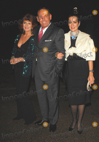 Rula Lenska Photo - London UK  Rula Lenska and Lorriane Chase with male guest  arriving at the Le Caprice 25th birthday party  3rd October 2006 SydLandmark Media