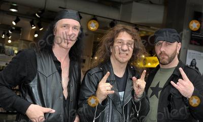 Anvil  Photo - London UK Metal band Anvil (l-r Robb Reiner Steve Kudlow and Glenn Five) appear at HMV Oxford Street to sign copies of their DVD The Story Of Anvil 16th June 2009Ali KadinskyLandmark Media