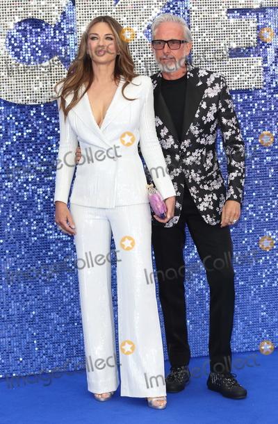 Elizabeth Hurley Photo - London UK Elizabeth Hurley and Patrick Cox at UK Premiere of Rocketman at the Odeon Luxe Leicester Square London on May 20th 2019 Ref LMK73-J4907-210519Keith MayhewLandmark MediaWWWLMKMEDIACOM