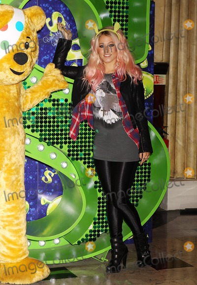 Pudsey Bear Photo - London UK X Factor finalist Amelia Lily joins Pudsey Bear at Shrek The Musical at  Theatre Royal Drury Lane  to celebrate her collaboration in this years BBC Children in Need POP Goes the Musical in London 29th October 2012J AdamsLandmark Media