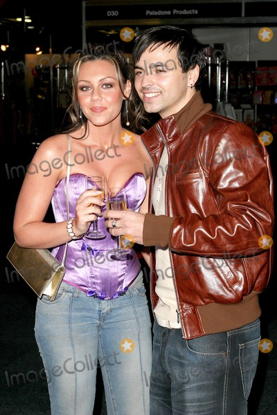 Andy Scott-Lee Photo - London Michelle Heaton from Liberty X  and her boyfriend Andy Scott Lee at the opening evening of Erotica 2004 Expo held at Olympia in Kensington 18 November 2004 RefLMK9-86_191104Paulo PirezLandmark Media
