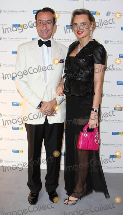 Robert Hanson Photo - London UK   Robert Hanson and partner Masha Markova at the Raisa Gorbachev Foundation Gala at Stud House Hampton Court London - 5th June 2010    Keith MayhewLandmark Media