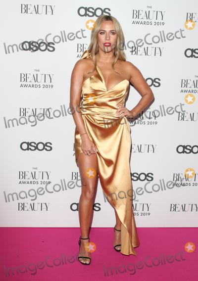 Pink Photo - LondonUK Caroline Flack  at  The Beauty Awards 2019 VIP Pink Carpet at City Central at the HAC Chiswell St London 25th November 2019RefLMK73-2625-261119Keith MayhewLandmark MediaWWWLMKMEDIACOM
