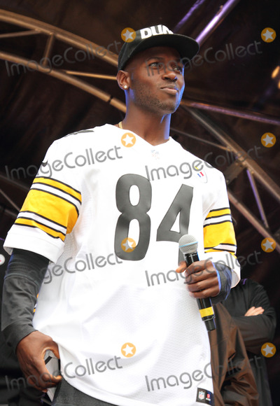 Antonio Brown Photo - London UK Antonio Brown at the NFL Block Party with Londons Regent Street closed to traffic on the eve of the NFL game between the Minnesota Vikings and the Pittsburgh Steelers at Wembley Stadium Attractions during the day included Cheerleaders Players from both teams and other performances on stage plus exhibits and demonstrations throughout the length of one of Londons busiest shopping streets Regent Street London 28th September 2013 RefLMK73-45420-290913Keith MayhewLandmark MediaWWWLMKMEDIACOM