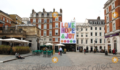 Covent Garden Photo - London UK   A giant four storey tall outdoor art installation with the words of Love Hope  Joy emblazoned across a building overlooking the Covent Garden Piazza welcoming Londoners back to the city after the Covid-19 lockdown Typography Artist Anthony Burrill was commissioned by Covent Garden 3rd July 2020 RefLMK73-S3050-050720Keith MayhewLandmark Media WWWLMKMEDIACOM