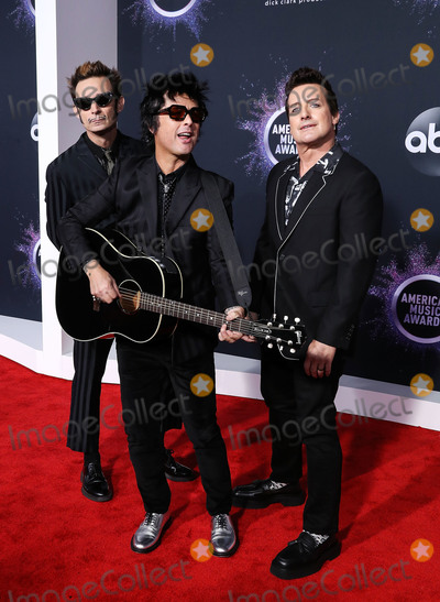 Billie Joe Armstrong Photo - LOS ANGELES CALIFORNIA USA - NOVEMBER 24 Mike Dirnt Billie Joe Armstrong and Tre Cool of Green Day arrive at the 2019 American Music Awards held at Microsoft Theatre LA Live on November 24 2019 in Los Angeles California United States (Photo by Xavier CollinImage Press Agency)
