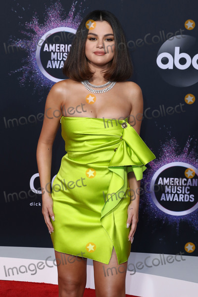Selena Gomez Photo - LOS ANGELES CALIFORNIA USA - NOVEMBER 24 Singer Selena Gomez wearing a Versace dress arrives at the 2019 American Music Awards held at Microsoft Theatre LA Live on November 24 2019 in Los Angeles California United States (Photo by Xavier CollinImage Press Agency)