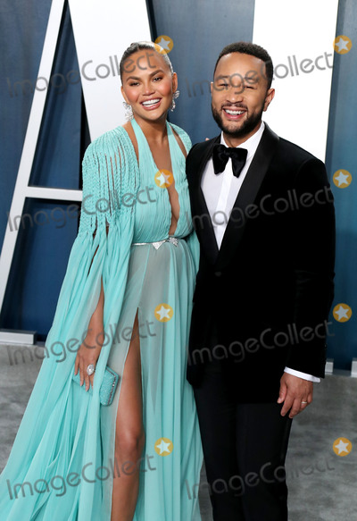 JOHN  LEGEND Photo - BEVERLY HILLS LOS ANGELES CALIFORNIA USA - FEBRUARY 09 Chrissy Teigen and John Legend arrive at the 2020 Vanity Fair Oscar Party held at the Wallis Annenberg Center for the Performing Arts on February 9 2020 in Beverly Hills Los Angeles California United States (Photo by Xavier CollinImage Press Agency)