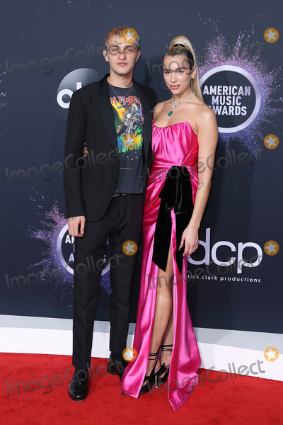 Anwar Hadid Photo - LOS ANGELES CALIFORNIA USA - NOVEMBER 24 Anwar Hadid and singer Dua Lipa arrive at the 2019 American Music Awards held at Microsoft Theatre LA Live on November 24 2019 in Los Angeles California United States (Photo by Xavier CollinImage Press Agency)