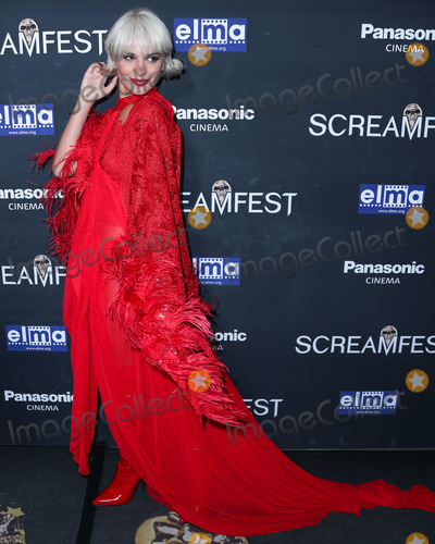 The Darkness Photo - HOLLYWOOD LOS ANGELES CALIFORNIA USA - OCTOBER 17 Model Ava Marie Capra arrives at the Screamfest Closing Night Screening Of We Summon The Darkness held at TCL Chinese 6 Theatres on October 17 2019 in Hollywood Los Angeles California United States (Photo by Xavier CollinImage Press Agency)