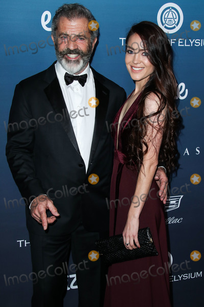 Mel Torm Photo - LOS ANGELES CA USA - JANUARY 05 Actor Mel Gibson and wife Rosalind Ross arrive at The Art Of Elysiums 12th Annual Heaven Gala held at a Private Venue on January 5 2019 in Los Angeles California United States (Photo by Xavier CollinImage Press Agency)