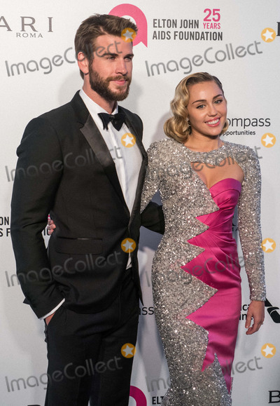 TI Photo - (FILE) Miley Cyrus and Liam Hemsworth Appear to Be Married Miley Cyrus and Liam Hemsworth appeared to have tied the knot six years after getting engaged Miley Cyrus and Liam Hemsworth are believed to have tied the knot in a low-key ceremony at home The singer 26 and actor 28 who got engaged six years ago have been seen cutting their wedding cake in a series of photos on social media WEST HOLLYWOOD LOS ANGELES CA USA - MARCH 04 Actor Liam Hemsworth and girlfriendsinger Miley Cyrus arrive at the 26th Annual Elton John AIDS Foundations Academy Awards Viewing Party held at The City of West Hollywood Park on March 4 2018 in West Hollywood Los Angeles California United States (Photo by Kenneth ChanImage Press Agency)