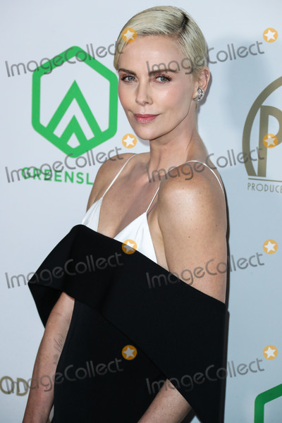 Givenchy Photo - (FILE) Charlize Theron Announces 1 Million Dollar Donation Amid Coronavirus COVID-19 Pandemic Charlize Theron has donated 1 million dollars to the coronavirus relief efforts through her foundation The Charlize Theron Africa Outreach Project and partners CARE and the Entertainment Industry Foundation (EIF) HOLLYWOOD LOS ANGELES CALIFORNIA USA - JANUARY 18 Actress Charlize Theron wearing a Givenchy dress arrives at the 31st Annual Producers Guild Awards held at the Hollywood Palladium on January 18 2020 in Hollywood Los Angeles California United States (Photo by Xavier CollinImage Press Agency)