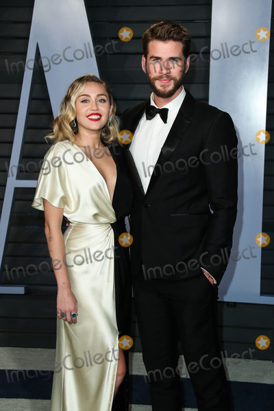 Miley Cyrus Photo - (FILE) Miley Cyrus and Liam Hemsworth Split BEVERLY HILLS LOS ANGELES CALIFORNIA USA - MARCH 04 Singer Miley Cyrus and boyfriendactor Liam Hemsworth arrive at the 2018 Vanity Fair Oscar Party held at the Wallis Annenberg Center for the Performing Arts on March 4 2018 in Beverly Hills Los Angeles California United States (Photo by Xavier CollinImage Press Agency)