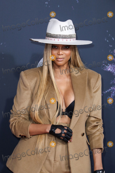 Tyra Banks Photo - LOS ANGELES CALIFORNIA USA - NOVEMBER 24 Model Tyra Banks wearing a Don Morphy suit arrives at the 2019 American Music Awards held at Microsoft Theatre LA Live on November 24 2019 in Los Angeles California United States (Photo by Xavier CollinImage Press Agency)
