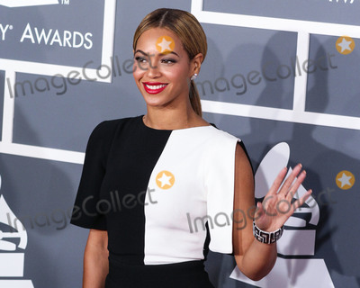 Beyonce Photo - (FILE) Beyonc named musics most powerful woman by BBC Womans Hour power list The superstar came first in a list of the industrys 40 most influential women thanks to her feminism activism and empowering musical messages LOS ANGELES CA USA - FEBRUARY 10 Singer Beyonce wearing an Osman black crepe jumpsuit with white panel detailing a Swarovski clutch Jimmy Choo shoes and Lorraine Schwartz jewelry arrives at the 55th Annual GRAMMY Awards held at Staples Center on February 10 2013 in Los Angeles California United States (Photo by Xavier CollinImage Press Agency)