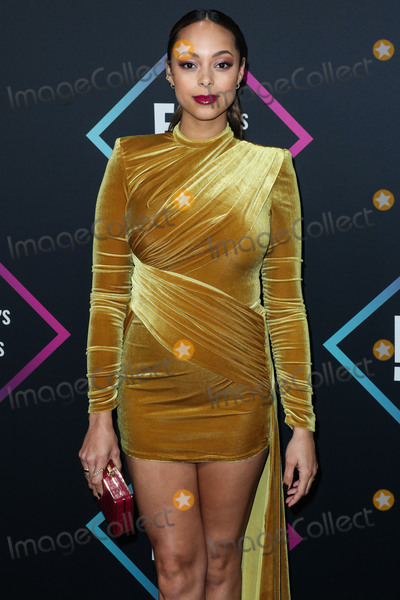 Amber Stevens-West Photo - SANTA MONICA LOS ANGELES CA USA - NOVEMBER 11 Actress Amber Stevens West wearing a Michael Costello dress Jimmy Choo shoes a Michael Kors clutch and Melinda Maria jewelry arrives at the Peoples Choice Awards 2018 held at Barker Hangar on November 11 2018 in Santa Monica Los Angeles California United States (Photo by Xavier CollinImage Press Agency)