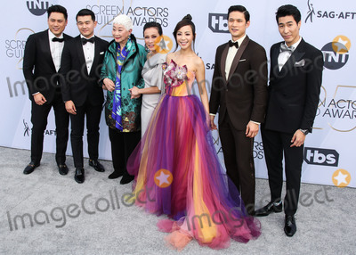 Harry Shum Jr Photo - LOS ANGELES CA USA - JANUARY 27 Jon M Chu Ronny Chieng Lisa Lu Tan Kheng Hua Fiona Xie Harry Shum Jr and Chris Pang arrive at the 25th Annual Screen Actors Guild Awards held at The Shrine Auditorium on January 27 2019 in Los Angeles California United States (Photo by Xavier CollinImage Press Agency)