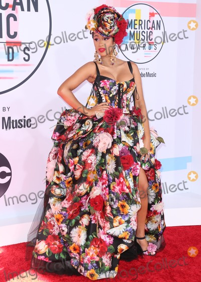 Dolce and Gabbana Photo - LOS ANGELES CA USA - OCTOBER 09 Rapper Cardi B aka Belcalis Marlenis Almanzar wearing a Dolce and Gabbana dress styled by Kollin Carter arrives at the 2018 American Music Awards held at the Microsoft Theatre LA Live on October 9 2018 in Los Angeles California United States (Photo by David AcostaImage Press Agency)