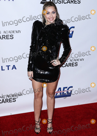 Miley Cyrus Photo - (FILE) Miley Cyrus Helps MAC Announce a 10 Million Donation for Coronavirus COVID-19 Pandemic Relief LOS ANGELES CALIFORNIA USA - FEBRUARY 08 Singer Miley Cyrus wearing a Francesco Scognamiglio dress arrives at the 2019 MusiCares Person Of The Year Honoring Dolly Parton held at the Los Angeles Convention Center on February 8 2019 in Los Angeles California United States (Photo by Xavier CollinImage Press Agency)