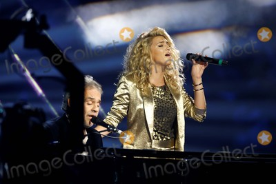Andrea Bocelli Photo - Musicians Andrea Bocelli (L) and Tori Kelly Perform at the 2015 Mtv Europe Music Awards Emas at Mediolanum Forum in Milan Italy on 25 February 2012 Photo Alec Michael