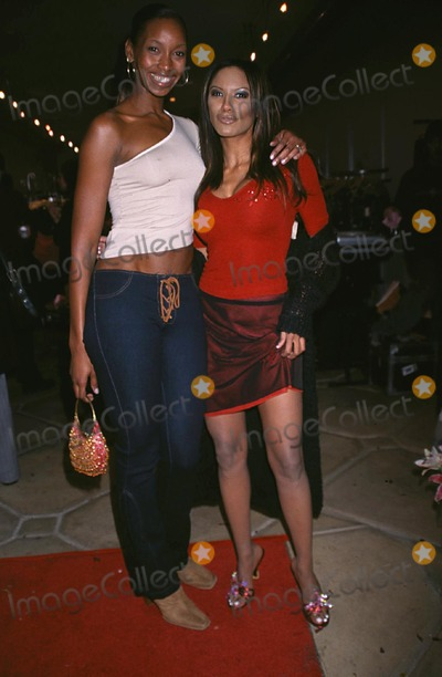 Traci Bingham Photo - benefit For 911 Fund Fiesta Boutique West Hollywood CA 11292001 Traci Bingham and Beverly Peele Photo by Ed GellerGlobe Photosinc