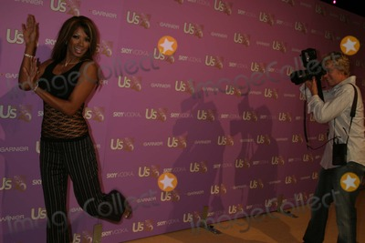 Traci Bingham Photo - Us Weeklys Young Hollywood Hot 20 Lax Hollywood CA 09-16-2005 Photo Clinton Hwallace-photomundo-Globe Photos Inc Traci Bingham Being Photographed on the Red Carpet