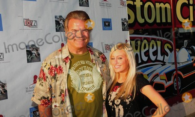 Abbey Scott Photo - Hollywood Celebrates The Release Of The Epic CD The End - A New Beginning and Launch Of The Elvis Hit Making Team Project in Barris Kustom City  North Hollywood California 09-22-2009Photo by John Krondes-Globe Photos incACTRESS ABBEY SCOTT WITH PR EXEC EDWARD LOZZIK63303JKRON
