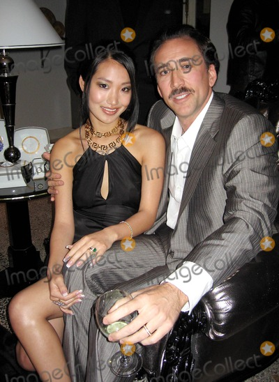 Alice Kim Photo - Versace Boutique Re-opening Party in Their Vip Room at 647 5th Ave New Yirk City 02-07-06 Photo by Jbarrett-allen-Globe Photoinc Alice Kim and Nicolas Cage