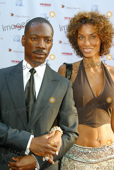 Nicole Mitchell Murphy Photo - Hollyrods 7th Annual Designcure Sponsored by Anheuser-busch and Outback Steakhouse Sugar Ray Leonard Estate Pacific Palisades CA 07-09-2005 Photo Clintonhwallace-photomundo-Globe Photos Inc Eddie Murphy and Wife Model Nicole Mitchell-murphy
