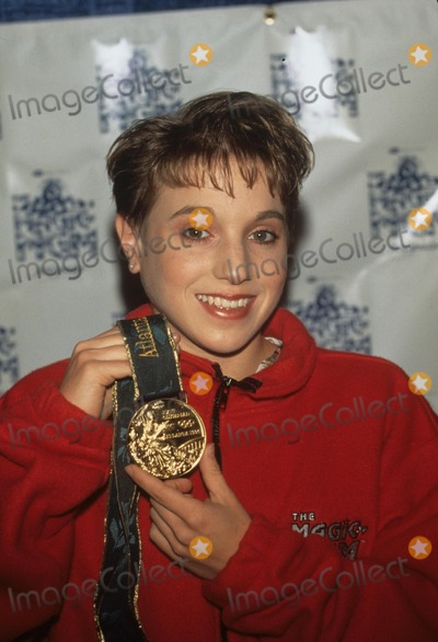 Kerri Strug Photo - Kerri Strug with Her Gold Medal at the Magic of Mgm Press Conference in Los Angeles 1996 K6120fb Photo by Fitzroy Barrett-Globe Photos Inc