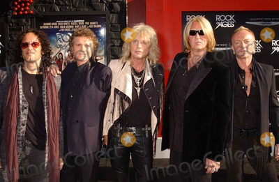 Def Leppard Photo - Def Leppard attends the Premiere of Rock of Ages at the Chinese Theater in Hollywoodca on June 82012 Photo by Phil Roach-ipol-Globe Photos