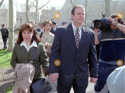 Abner Louima Photo - 4302_Brooklyn NY_Former NYC police officerCharles Schwarz walks with wife Andra after he was arraigned on perjury charges stemming from his trial  conviction of the torture of Haitiam immigrant Abner Louima in a Brooklyn police stationhouse bathroom(PhotoNeil Schneider)GLOBE PHOTOS INC 2002K24719NSCH