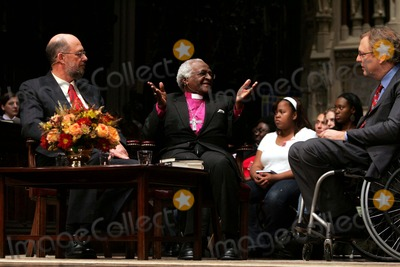 Archbishop Desmond Tutu Photo - K50334RMArchbishop Desmond Tutu and his biographer John Allen (L) at the Trinity Church to discuss Rabble Rouser for Peace The Authorized Autobiography of Desmond TutuBroadway and Wall Street New York City 10-18-2006Photo Rick Mackler  Rangefinders  Globe Photos Inc 2006