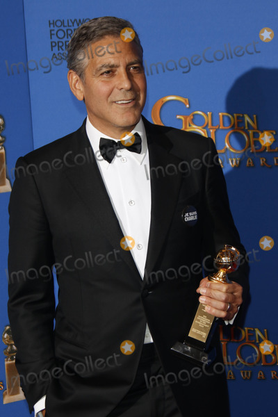 Cecil B DeMille Photo - Cecil B Demille Award Winner George Clooney Poses in the Pressroom of the 72nd Annual Golden Globe Awards Golden Globes in Beverly Hills Los Angeles USA on 11 January 2015 Photo Alec Michael