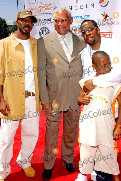 Ralph Tresvant Photo - Lincoln Presents 19th Annual a Midsummer Nights Magic Celebrityall-star Basketball Game at the Forum in Inglewood California 08012004 Photo by Valerie GoodloeGlobe Photos Inc 2004 Ralph Tresvant John Mack Michael Bivins and His Son