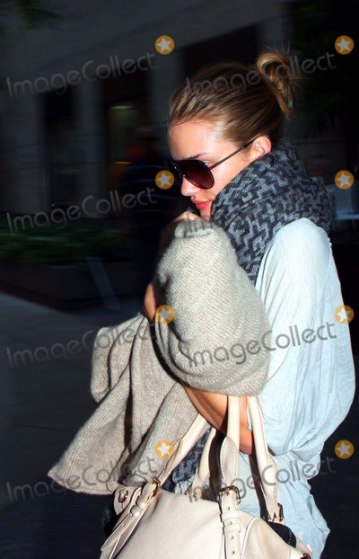 Rosie Huntington-Whitley Photo - Rosie Huntington Whitley Checking Out of the Four Seasons Hotel in New York City 06-29-2011 photo by Barry talesnick-ipol-globe Photos Inc 2011